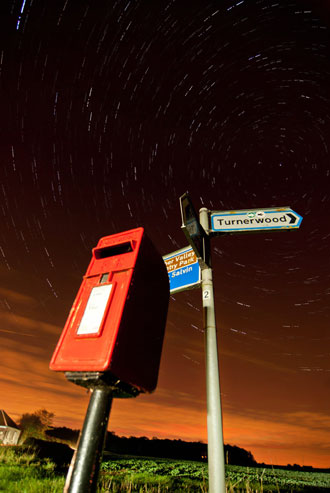 post box star trail illuminated with car headlights