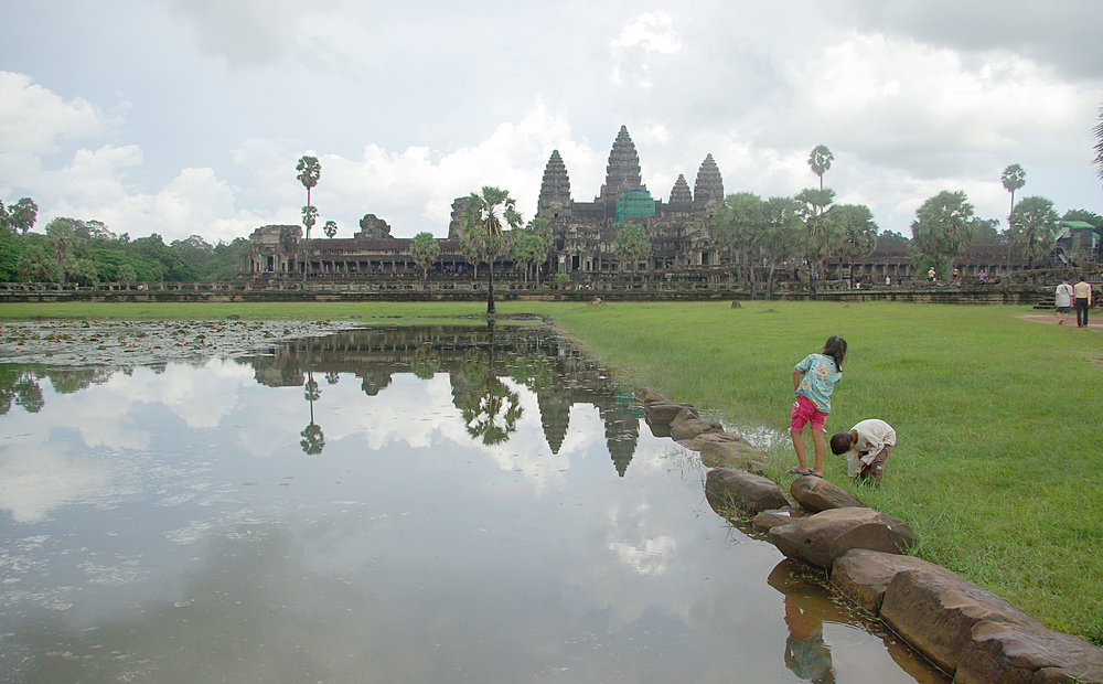 Children playing in front of Angkor Wat temple, Cambodia