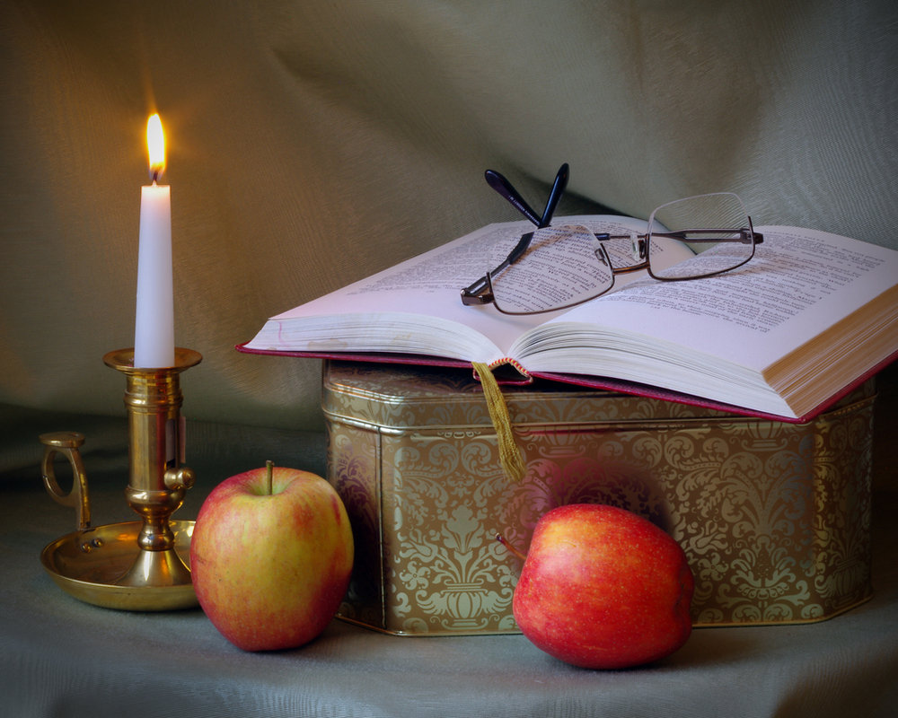 Book by candle light