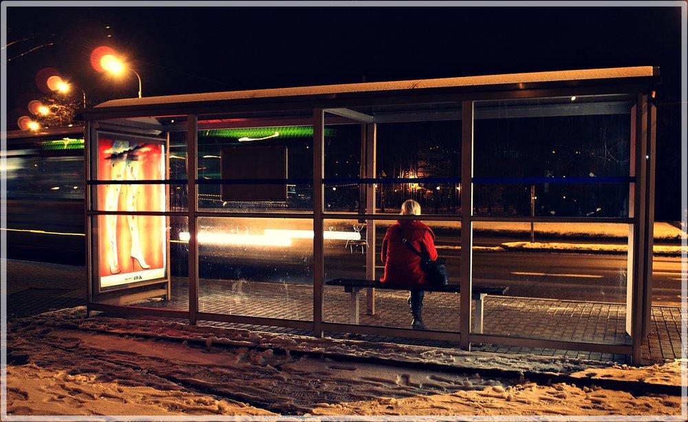 One legged women waits for night bus!