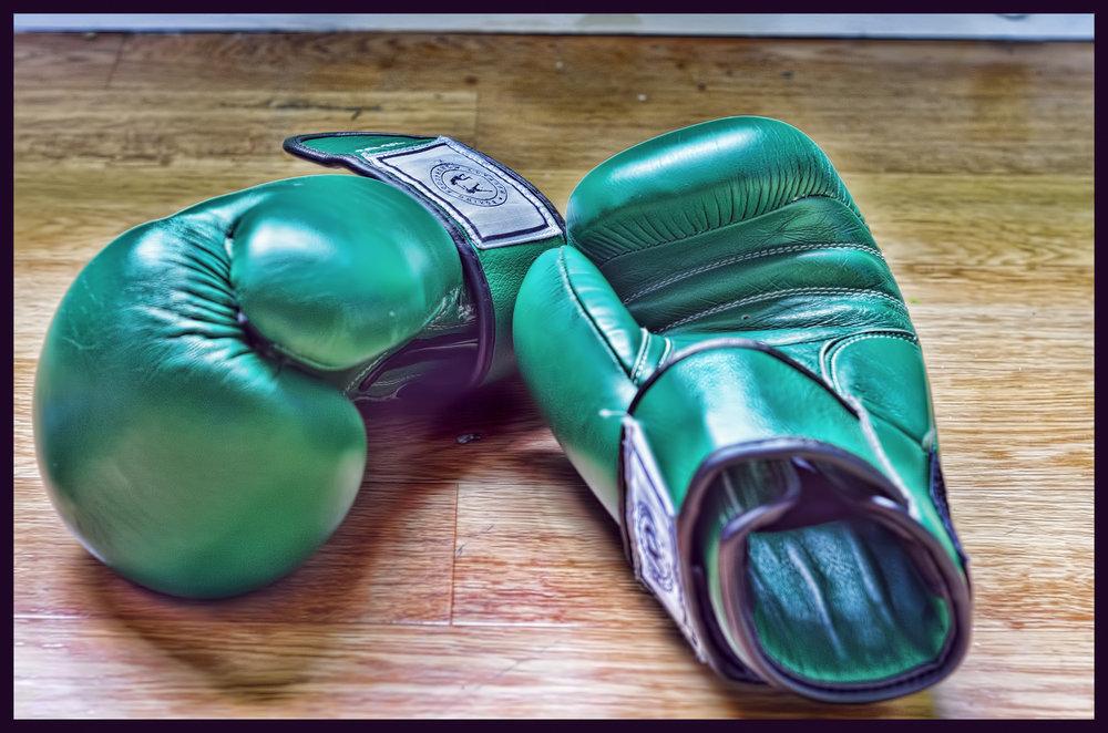 Green sparring gloves.
