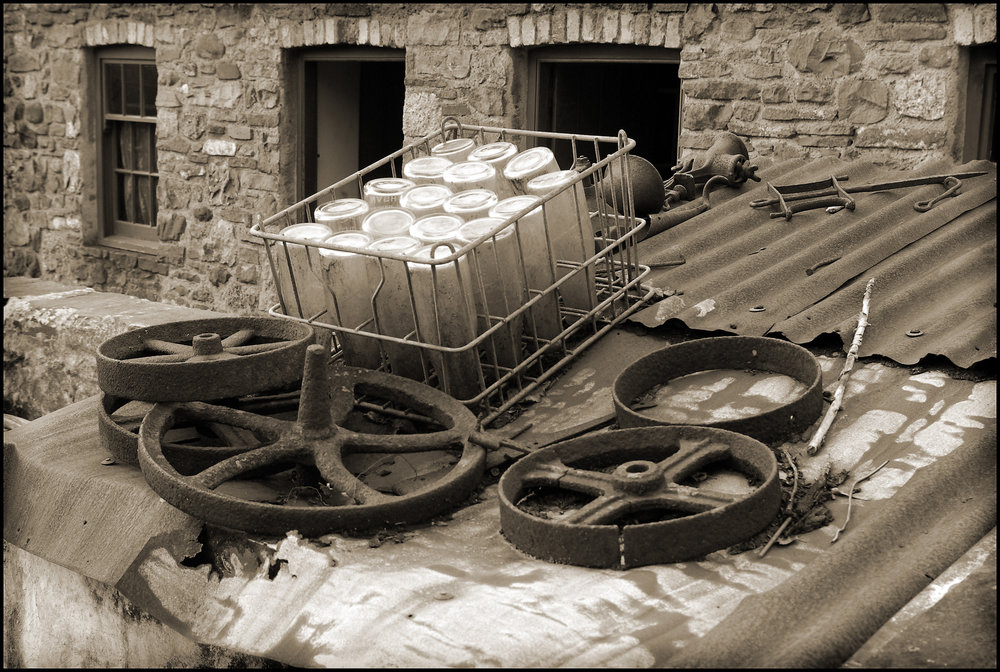 Crate and iron wheels on a cold tin roof