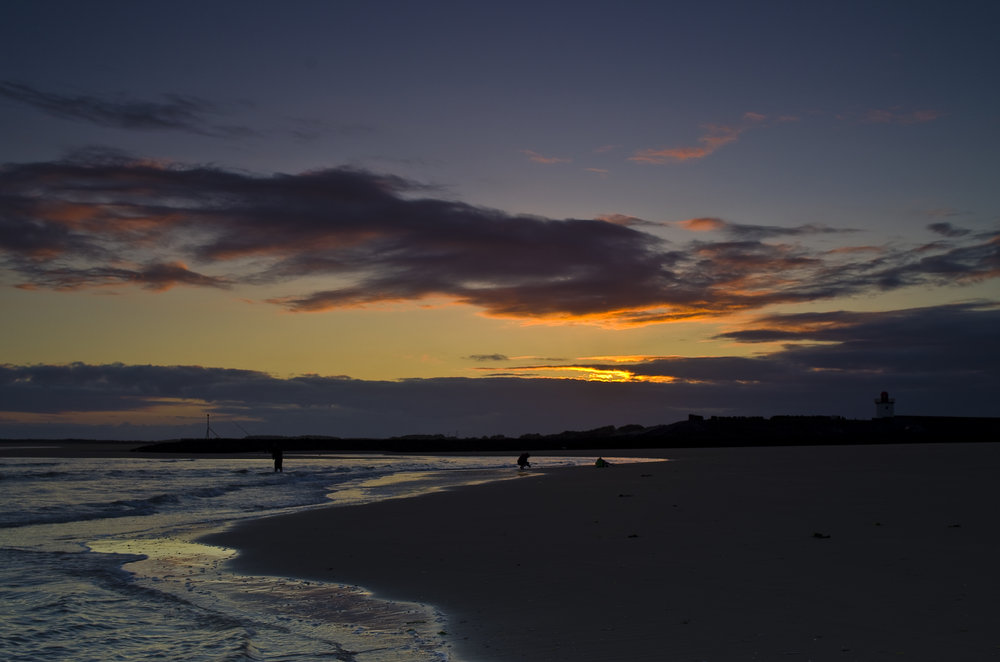 Burry Port Beach and lighthouse at sunset