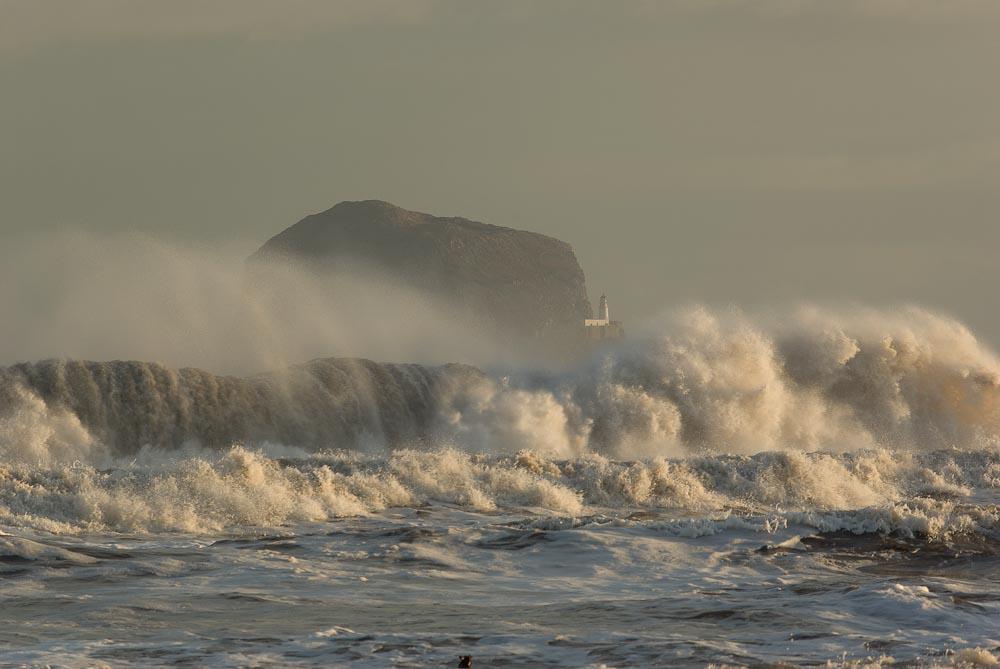 Bass Rock behind waves