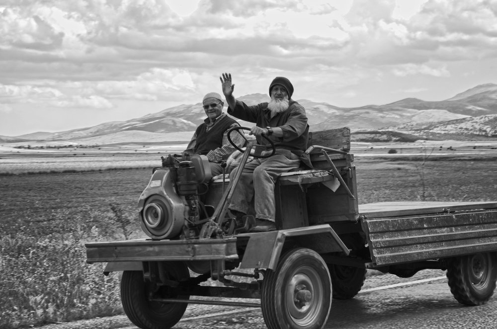Two Old Timers on a Strange Vehicle