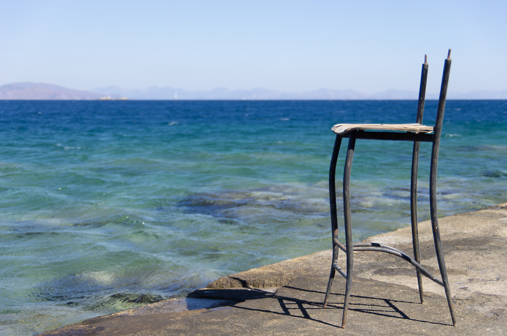..dilapidated stool with a view...