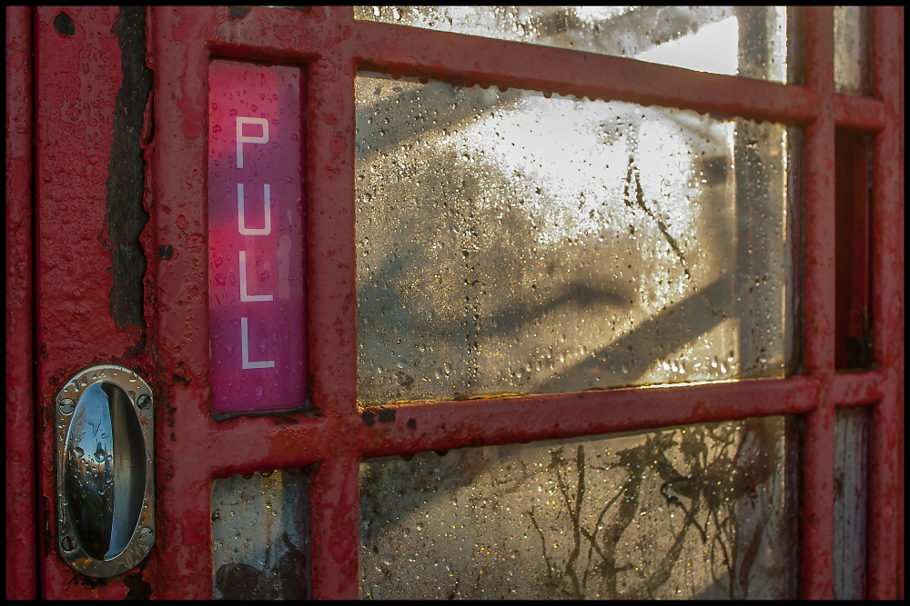 K6 Telephone Box with Condensation and early Sunshine