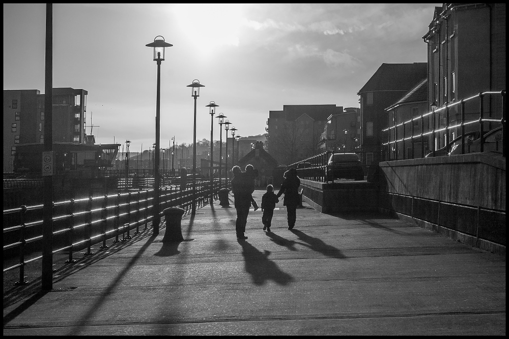 Long Family Shadows on the Dockside