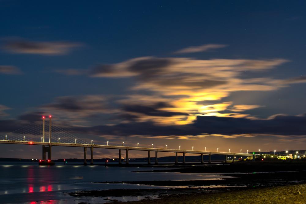 Kessock Bridge with the Harvest Moon hiding