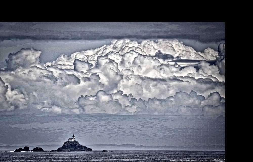 Changing weather behind the phare de Tevenec in the Mer d'Iroise