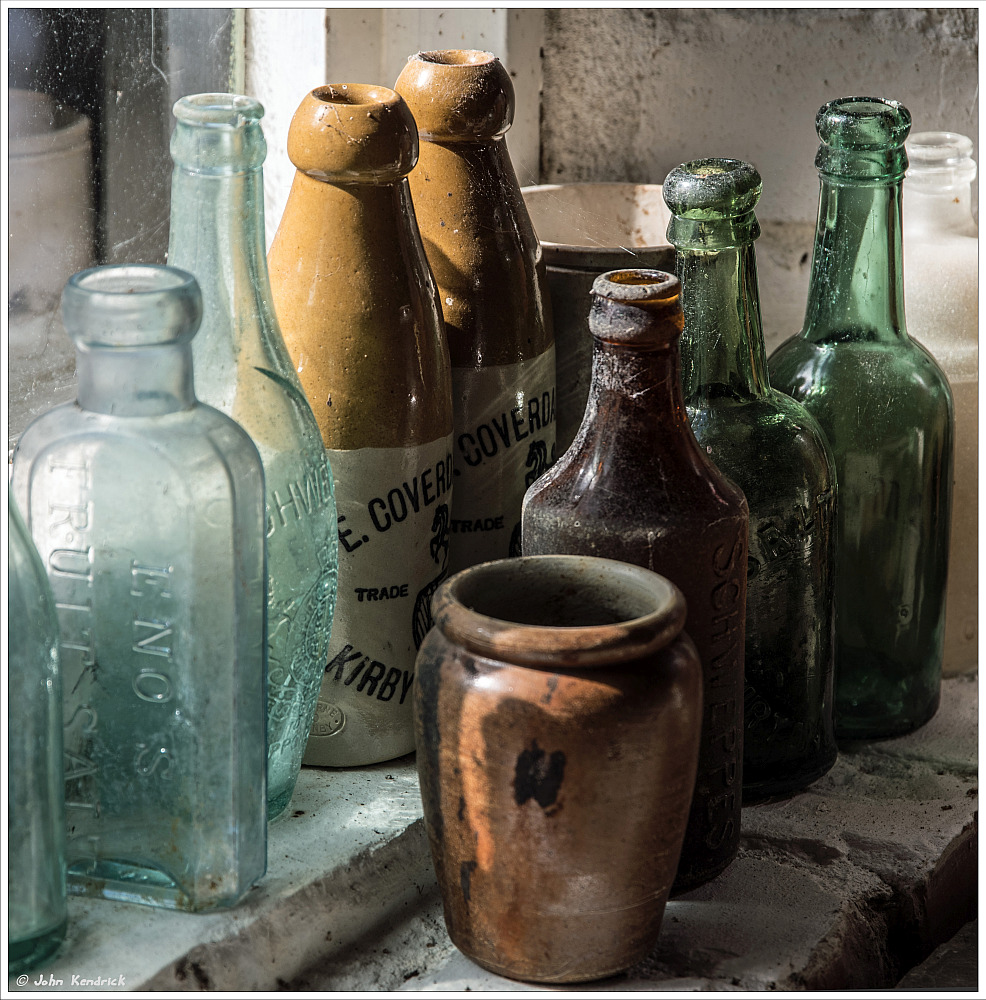 Dusty Bottles on Windowsill