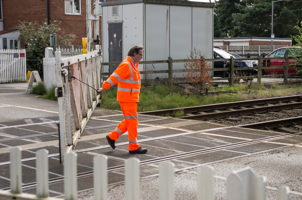 The man who operates the railway crossing.....