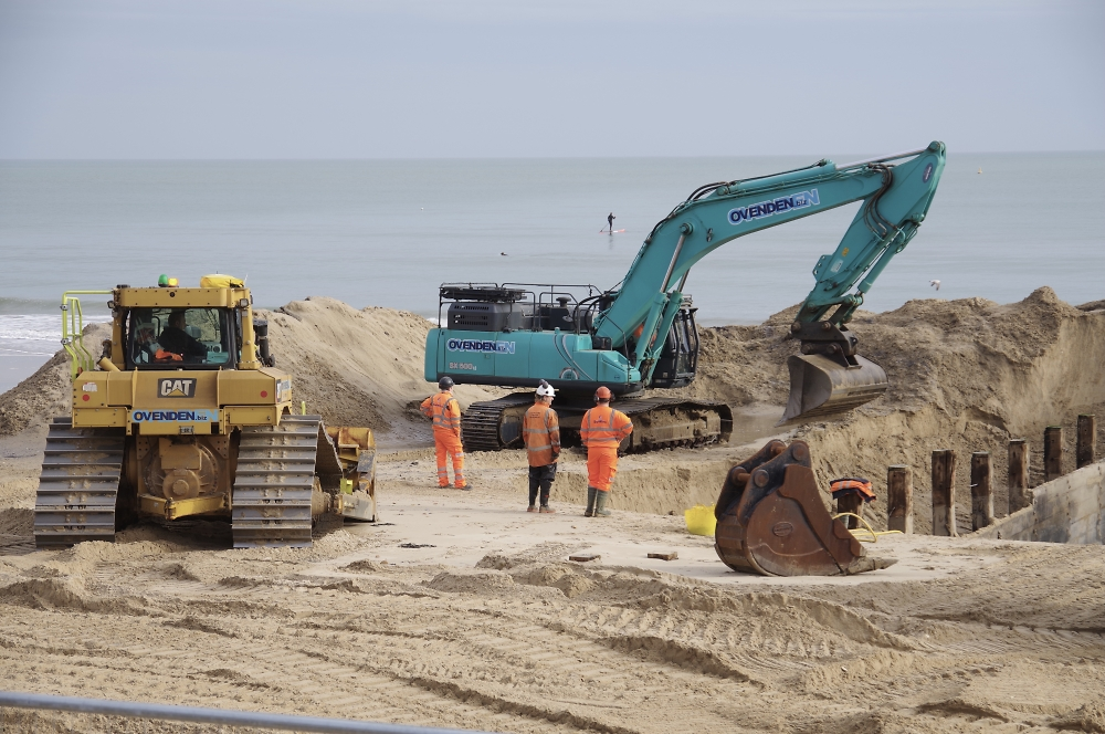 Replacing grounds on Bournemouth beach.