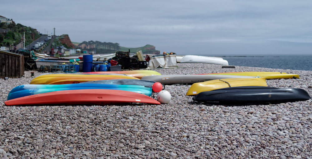 Resting Boats, Kayaks and Paddle Boards