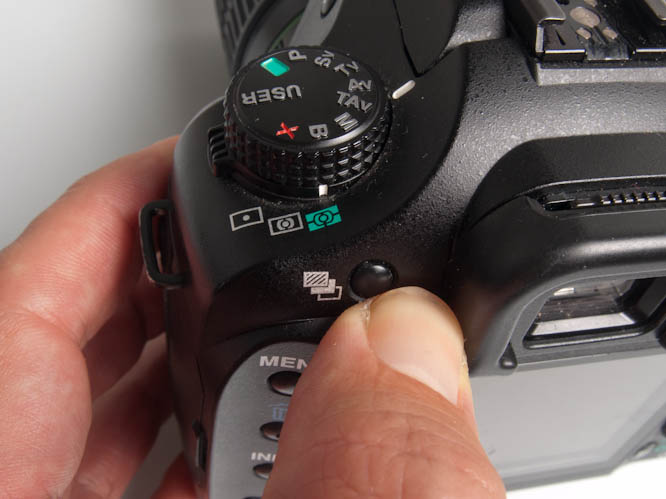 Pentax K20D button for auto-bracketing